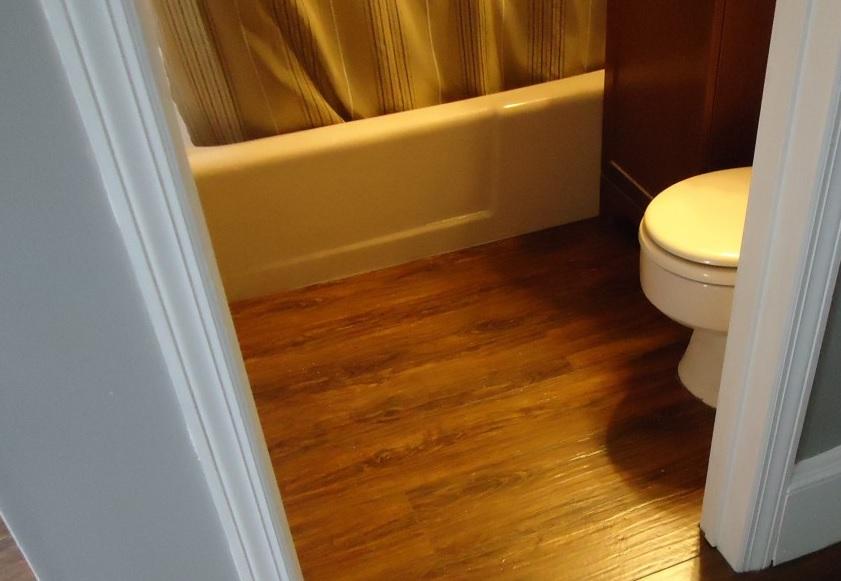 laminate flooring in bathrooms pros cons