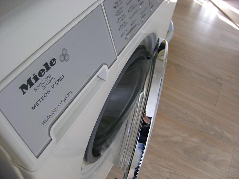 how to stop washing machine moving on laminate floor